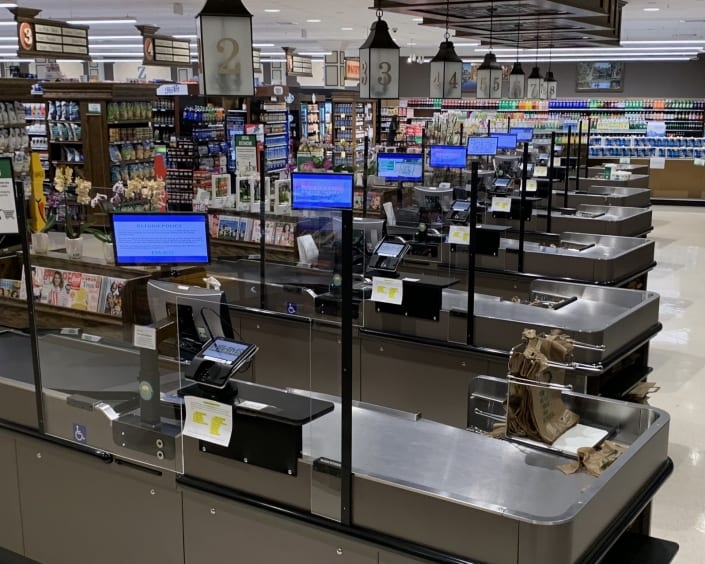 grocery store with plexiglass protection shields